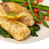 Baked Fish. Fillet on white background. Selective focus Stock Image