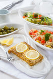 Baked fish fillet wih couscous salad Stock Image