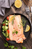 Baked fish. Fillet on wood Stock Image