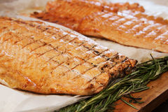Baked fish fillets. With rosemary on the table Stock Photos