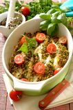 Baked fish fillets topped with crispy fried onion and herbs. royalty free stock photography