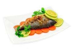 Baked fish with fresh lemon Royalty Free Stock Photography