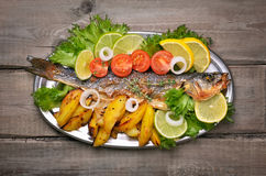 Baked fish with fresh vegetables and fried potato Stock Images