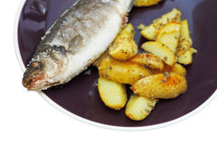 Baked fish and fried potatoes on plate Stock Photography