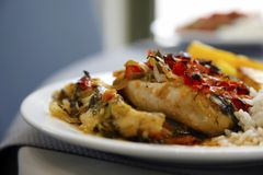 Baked fish with garnish stock image