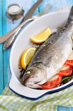 Baked fish with herbs, vegetables and garlic, selective focus Royalty Free Stock Photography