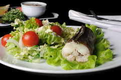 Baked fish (King clip) with vegetables Stock Photo