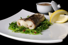 Baked fish (King clip) with vegetables Stock Image