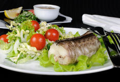 Baked fish (King clip) with vegetables Royalty Free Stock Photos