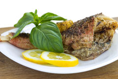 Baked fish with lemon Stock Photos