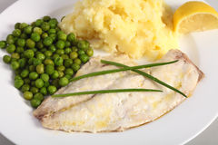 Baked fish, lemon and vegetables Stock Photography