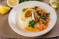 Baked fish with mashed potatoes stock images