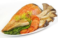 Baked fish with mushrooms Stock Images