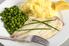 Baked fish with peas and potato Royalty Free Stock Photos