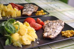 Baked fish with potatoes. On the plate Royalty Free Stock Images