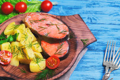 Baked fish with potatoes Stock Image