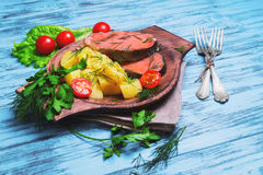 Baked fish with potatoes Stock Images