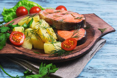 Baked fish with potatoes Royalty Free Stock Photography
