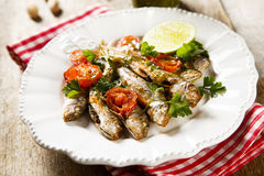 Baked fish. Baked red mullets with piastacho sauce Royalty Free Stock Photography