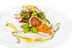 Baked fish with salad Stock Images