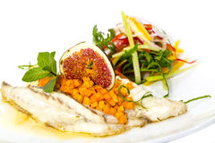 Baked fish with salad Royalty Free Stock Image