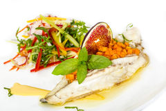 Baked fish with salad Stock Photos