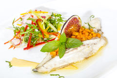 Baked fish with salad Royalty Free Stock Photos