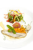Baked fish with salad Royalty Free Stock Images