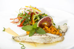 Baked fish with salad Stock Photography
