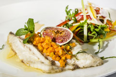 Baked fish with salad Royalty Free Stock Photography