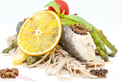 Baked fish with spaghetti Royalty Free Stock Images