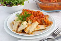 Baked fish in tomato sauce with vegetables Stock Photography
