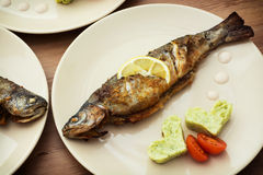 Baked fish with two hearts Royalty Free Stock Photos
