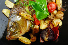 Baked fish with vegetables Royalty Free Stock Image