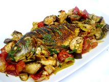 Baked fish. And baked vegetables Stock Photo
