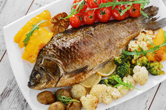 Baked fish with vegetables Stock Photography