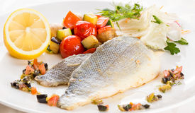 Baked fish with vegetables and lemon. Royalty Free Stock Photo