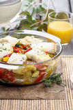 Baked fish with vegetables Stock Image