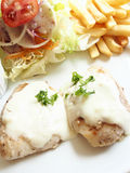 Baked fish white sauce Royalty Free Stock Image