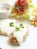 Baked fish white sauce Stock Photo