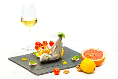 Baked fish with wine Royalty Free Stock Images