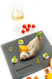 Baked fish with wine Royalty Free Stock Photos