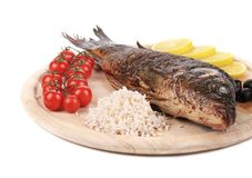 Baked fish on wooden board Stock Photography