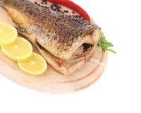 Baked fish on wooden board Royalty Free Stock Images