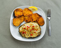 Baked Fish and Yam Slices Royalty Free Stock Photography