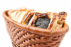 Baked flaky croissant. Freshly baked flaky croissant with poppy on a white background Royalty Free Stock Photo