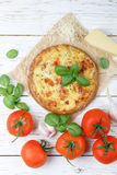 Baked flat bread with tomatoes, cheese, garlic and Basil Stock Photo