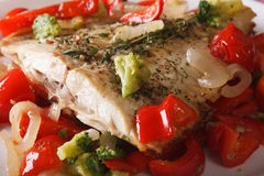 Baked flatfish with vegetables macro on a white plate. horizonta Stock Photos