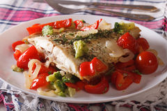Baked Flounder with peppers and broccoli close-up. horizontal Stock Photo
