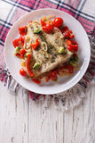 Baked flounder with seasonal vegetables. vertical top view Royalty Free Stock Photography